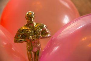 Oscar and balloons help make an entrance to your Oscar Party