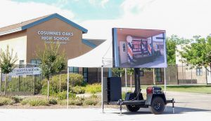 Outdoor graduation ceremony idea including a mobile LED screen for daytime celebrations