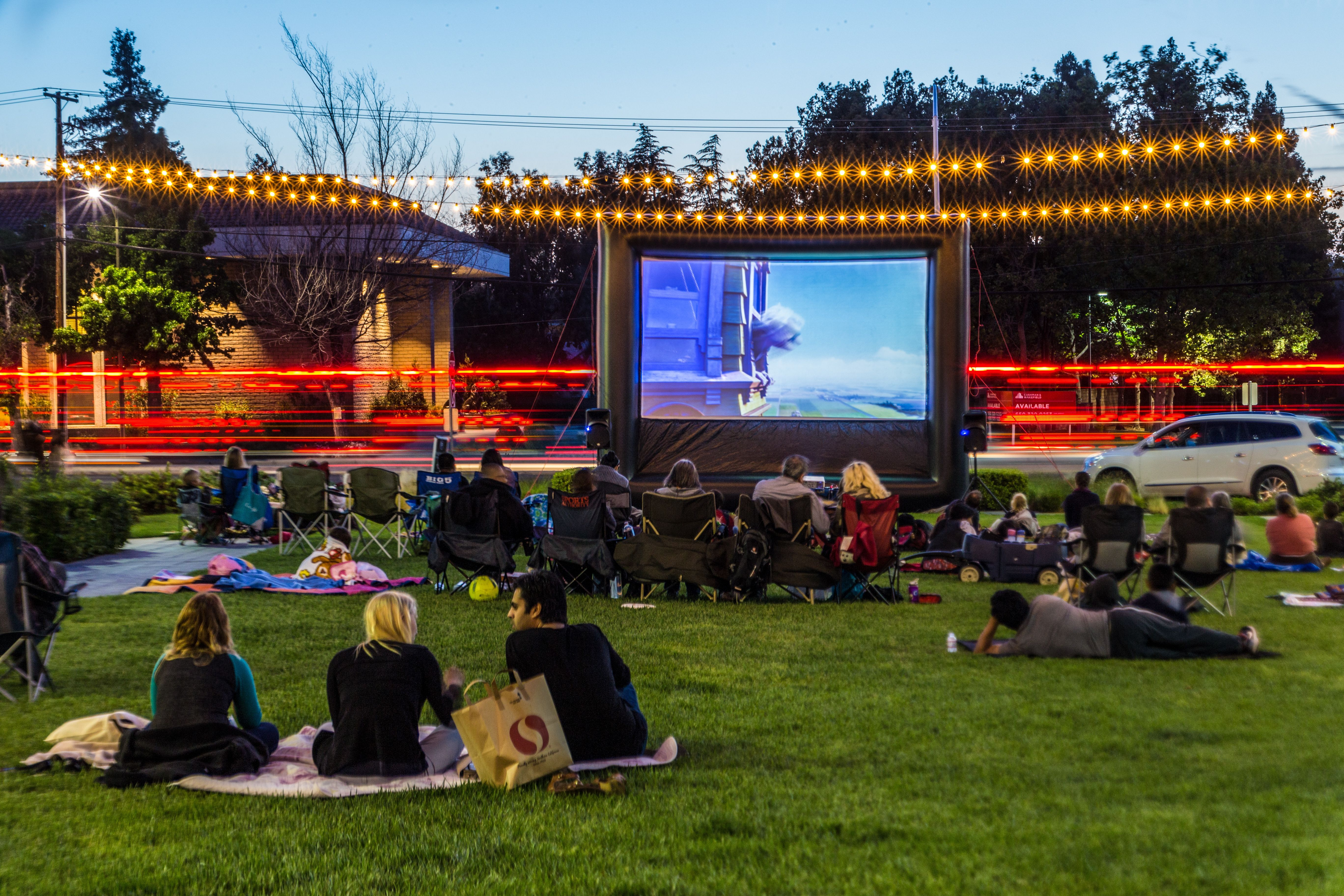 Church family fun night ideas include an outdoor movie for the community on the lawn hosted by FunFlicks®.