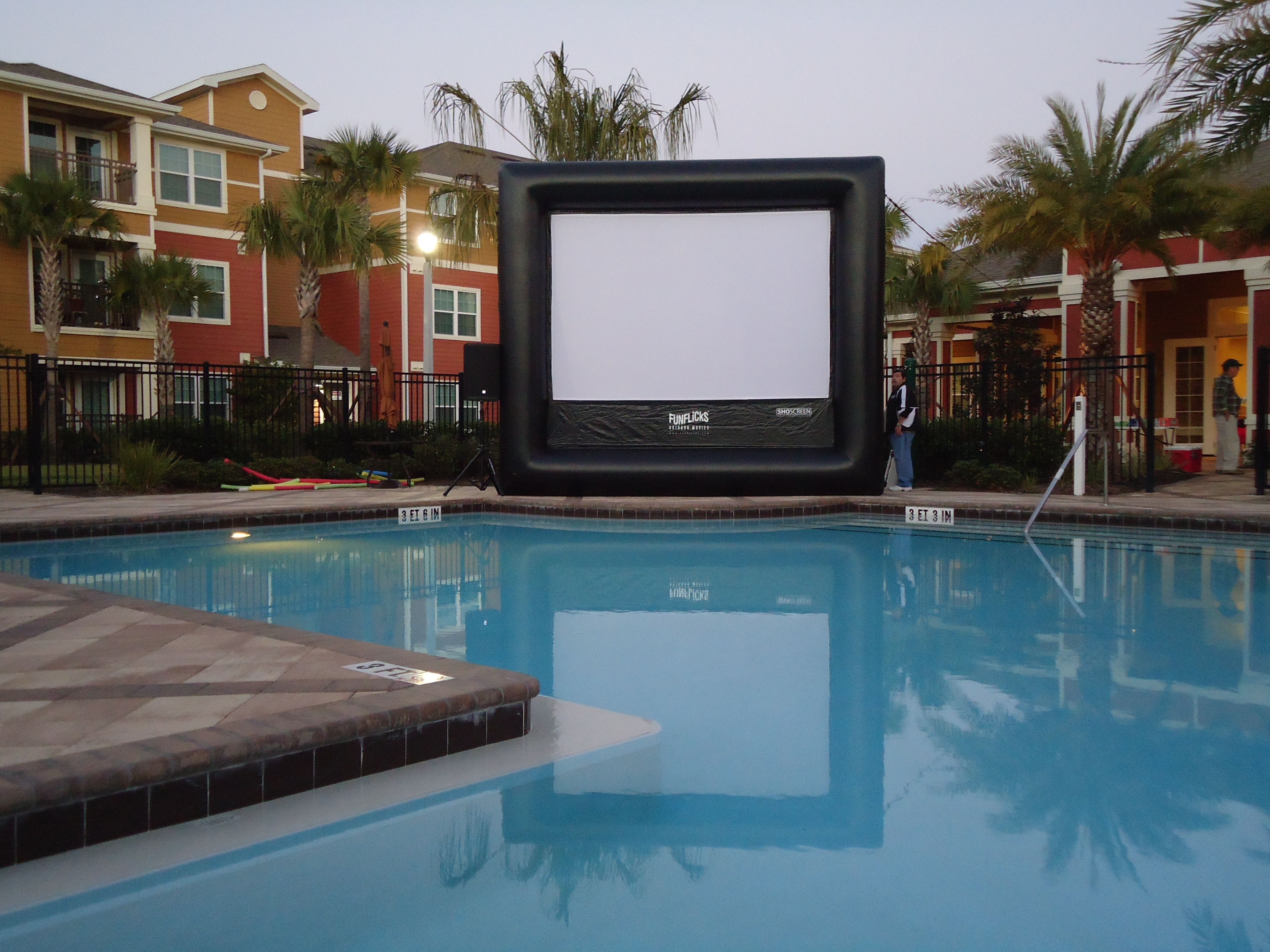 """Poolside apartment resident movie equipment rental set-up for a """"dive-in' movie night by FunFlicks®"""